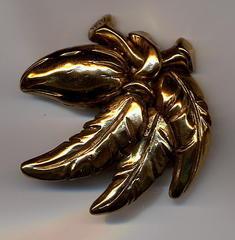 Broche cabosse en or fin n7